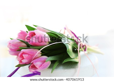 Beautiful pink tulips on a white background.