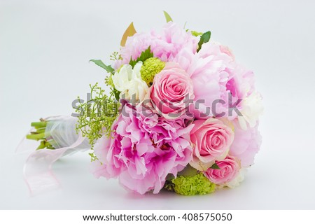 Beautiful pink wedding bouquet on white background - stock photo