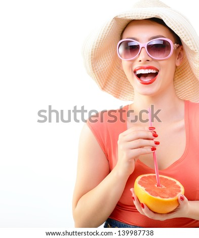 Beautiful pinup girl drinking juice of grapefruit in  sunglssses and panama hat, portrait of young happy smiling sexy woman in pin-up style, over white - stock photo
