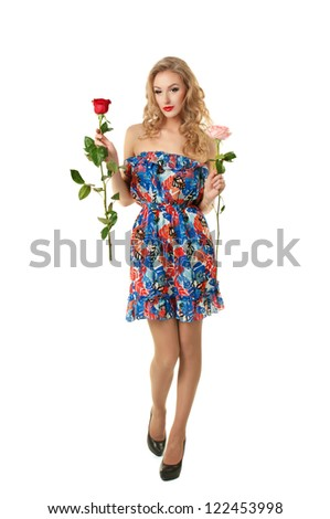 Beautiful pinup  girl make choice between two roses - stock photo