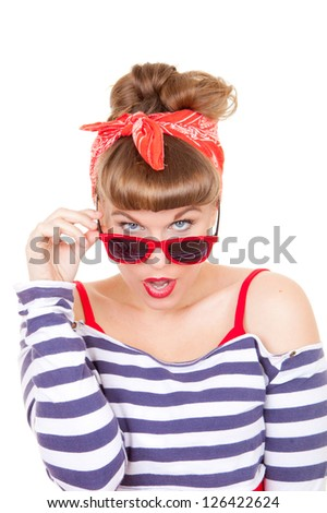 beautiful pinup woman looking over glasses - stock photo
