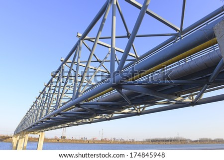 Beautiful pipeline bridge across a river in northern China   - stock photo