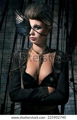 Beautiful pirate woman on her ship - stock photo