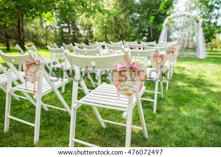 Beautiful Place For Outside Wedding Ceremony In City Park. Many White  Wooden Chairs Decorated With