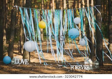 Beautiful place for outside wedding ceremony in wood. Wedding settings. Horizontal image. - stock photo
