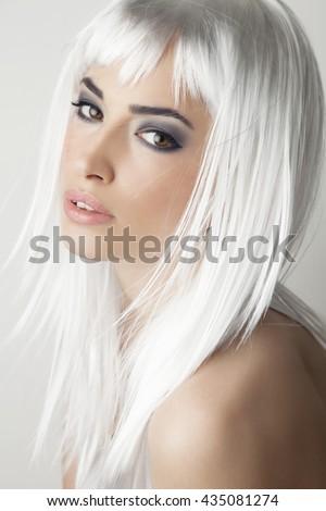 beautiful platinum blond woman with expressive dark makeup - stock photo