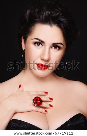 Beautiful plus-size busty woman with stylish make-up - stock photo