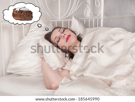 Beautiful plus size woman dreaming about cake - stock photo