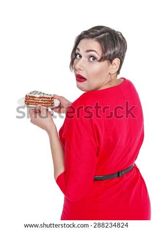 Beautiful plus size woman eating cake isolated over white - stock photo