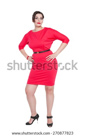 Beautiful plus size woman in red dress posing on white background
