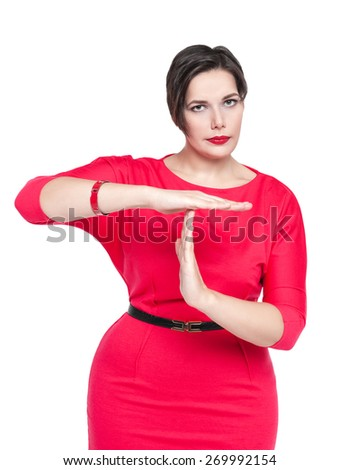 Beautiful plus size woman in red dress showing time out gesture isolated  - stock photo
