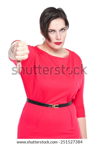 Beautiful plus size woman in red dress with thumbs down gesture isolated  - stock photo