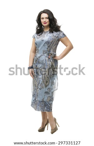 Beautiful plus size young woman with makeup and red lips wearing long dress. Isolated over white background.