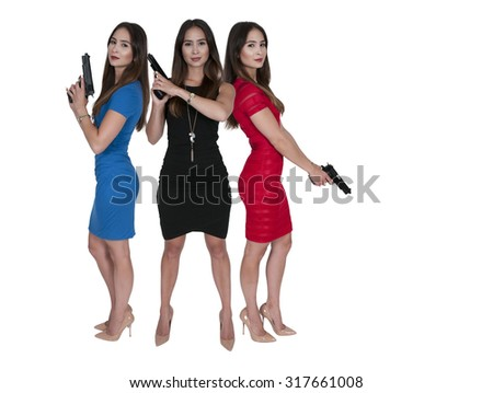 Beautiful police detective women on the job with guns - stock photo