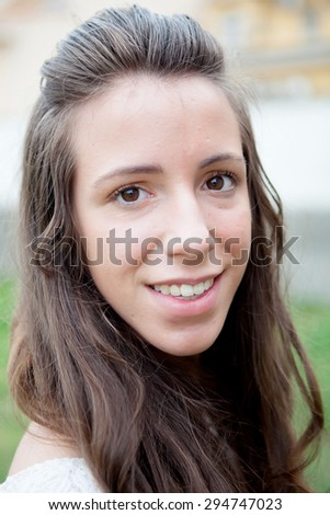 Beautiful portrait of a cool girl with brown eyes looking at camera