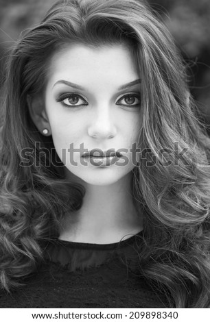 beautiful portrait of a fashion lady  outdoor, close-up shoot