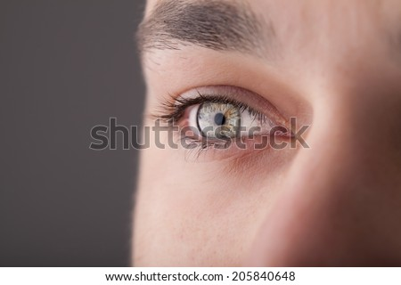 Beautiful portrait of a handsome man close up eye - stock photo