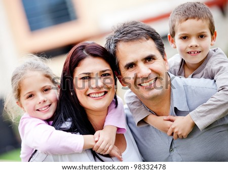 Beautiful portrait of a happy family smiling - outdoors - stock photo