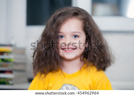 Beautiful portrait of a happy little girl - stock photo