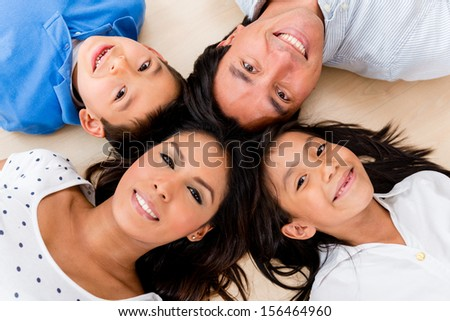 Beautiful portrait of a hispanic family with heads together  - stock photo