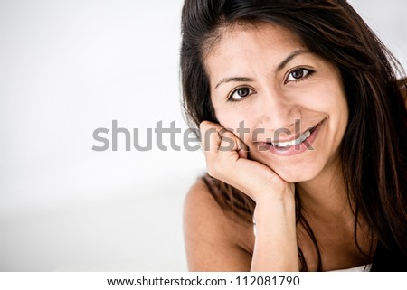 Beautiful portrait of a Latin woman smiling - stock photo