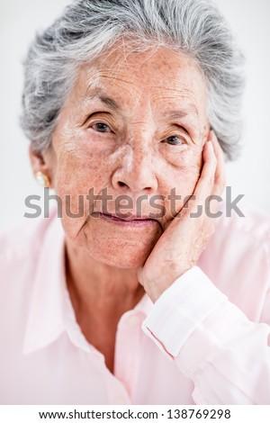 Beautiful portrait of a lovely elder woman - stock photo