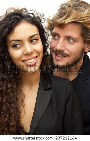 Beautiful portrait of a loving couple  on white background