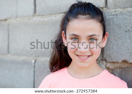 Beautiful portrait of a pretty girl with brown eyes outside - stock photo