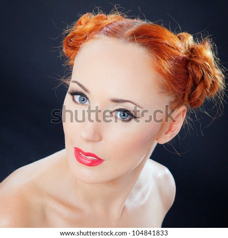 Beautiful portrait of a red hair woman with glamour bright makeup