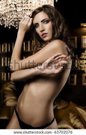 beautiful portrait of a sexy woman in a luxury room with black and gold color