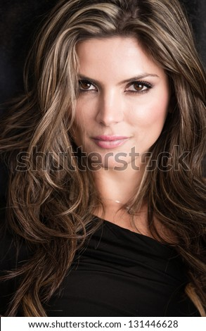 Beautiful portrait of a woman - isolated over black background - stock photo