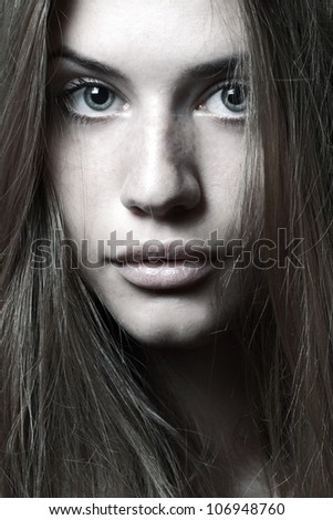 Beautiful portrait of an young adult woman, isolated on white - stock photo
