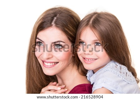 Beautiful portrait of hugging mother and daughter