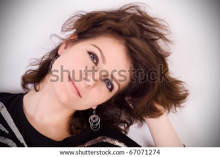 Beautiful portrait of pretty young woman with fashion eye make-up - stock photo
