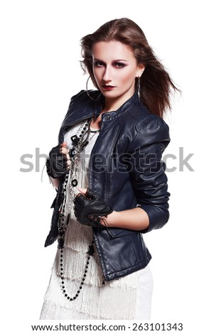 Beautiful portrait of rock woman model in leather jacket with dark evening make-up. Perfect street fashion. Personal accessories