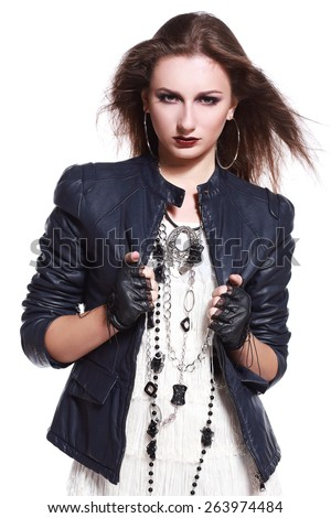 Beautiful portrait of rock woman model in leather jacket with dark evening make-up. Perfect street fashion. Personal accessories - stock photo