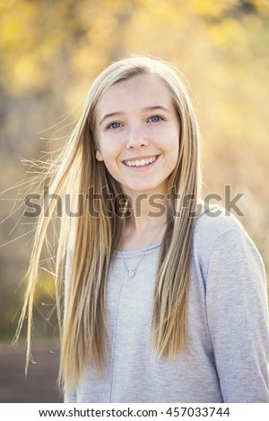 Beautiful Portrait of smiling teen girl outdoors