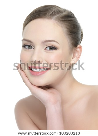 Beautiful portrait of smiling woman with healthy skin - isolated on white - stock photo