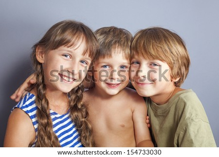 Beautiful portrait of two brothers and a sister - stock photo