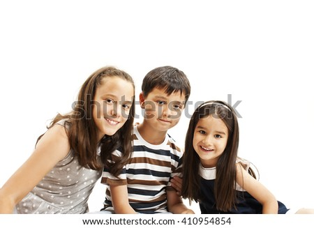 Beautiful portrait of two sisters and a brother. Isolated on white background - stock photo