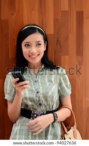 beautiful portrait young teenager girl outdoor with mobile phone - stock photo