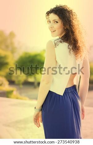 Beautiful Portuguese Woman Smiling at Sunset, Yellow Filter - stock photo