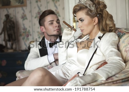 Beautiful, posh couple in luxury, historical mansion - stock photo