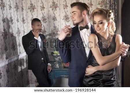 Beautiful, posh couple on the party in luxury apartment with friend