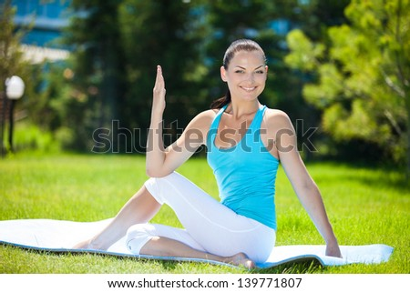 Beautiful positive brunette girl sit and exercisers in different yoga poses, series of photos