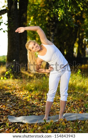 beautiful positive girl doing yoga in forest