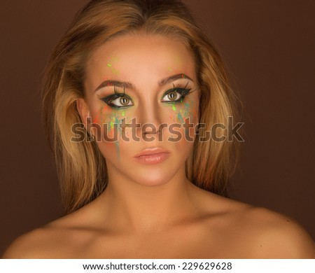 beautiful positive girl with bright make-up on background