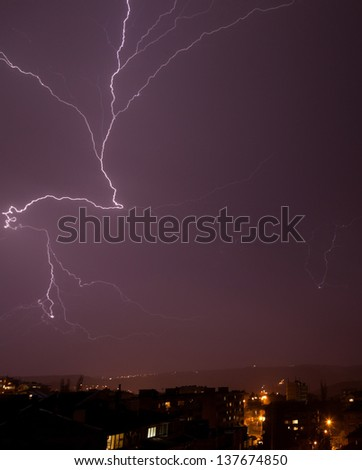 Beautiful powerful lightning over city - stock photo