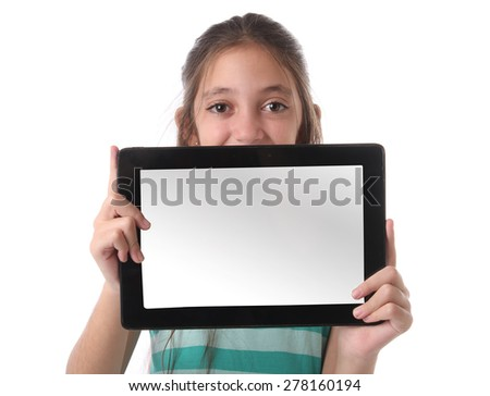 Beautiful pre-teen girl with a tablet computer. Isolated. Clipping path for the screen - stock photo