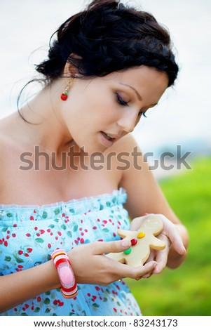 Beautiful pregnant belly in an outdoor - stock photo